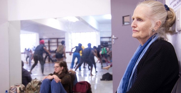 SCD editor Lauren Warnecke (background) watching a master class led by Moving into Dance Mophatong with Adrienne Sichel in Durban, South Africa (2018). Photo by Val Adamson.