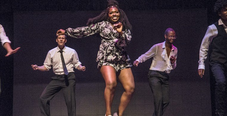 """Star Dixon (center) and M.A.D.D. Rhythms performing an ensemble section of """"Hoofin' It."""" Photo by Nate Crossley"""