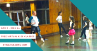 Young dancers in a wood paneled studio space face a mirror while a teacher and assistant demonstrate at the front.